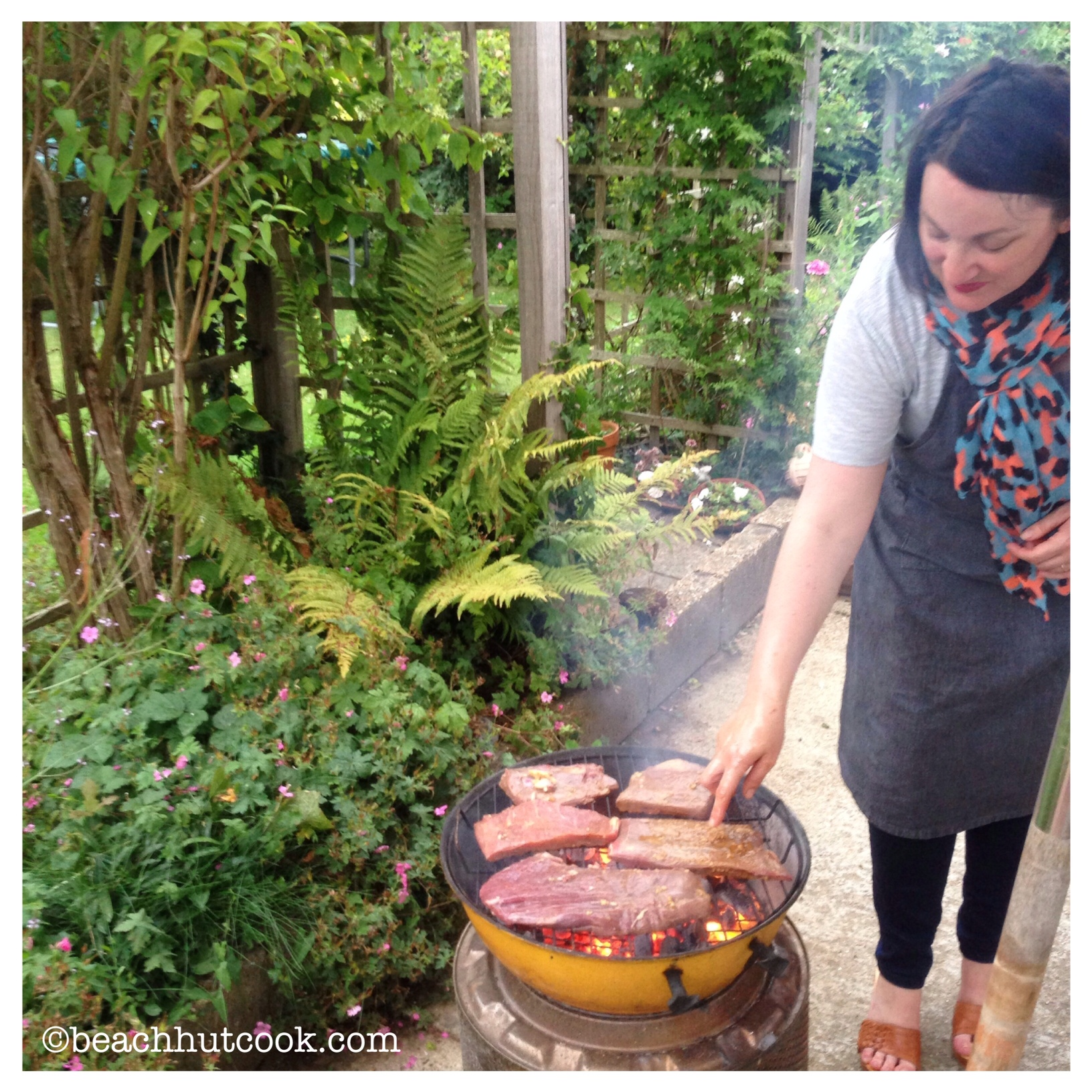 Beachhutcook shows How to Barbecue in the Rain - Feeding Steak for a Crowd