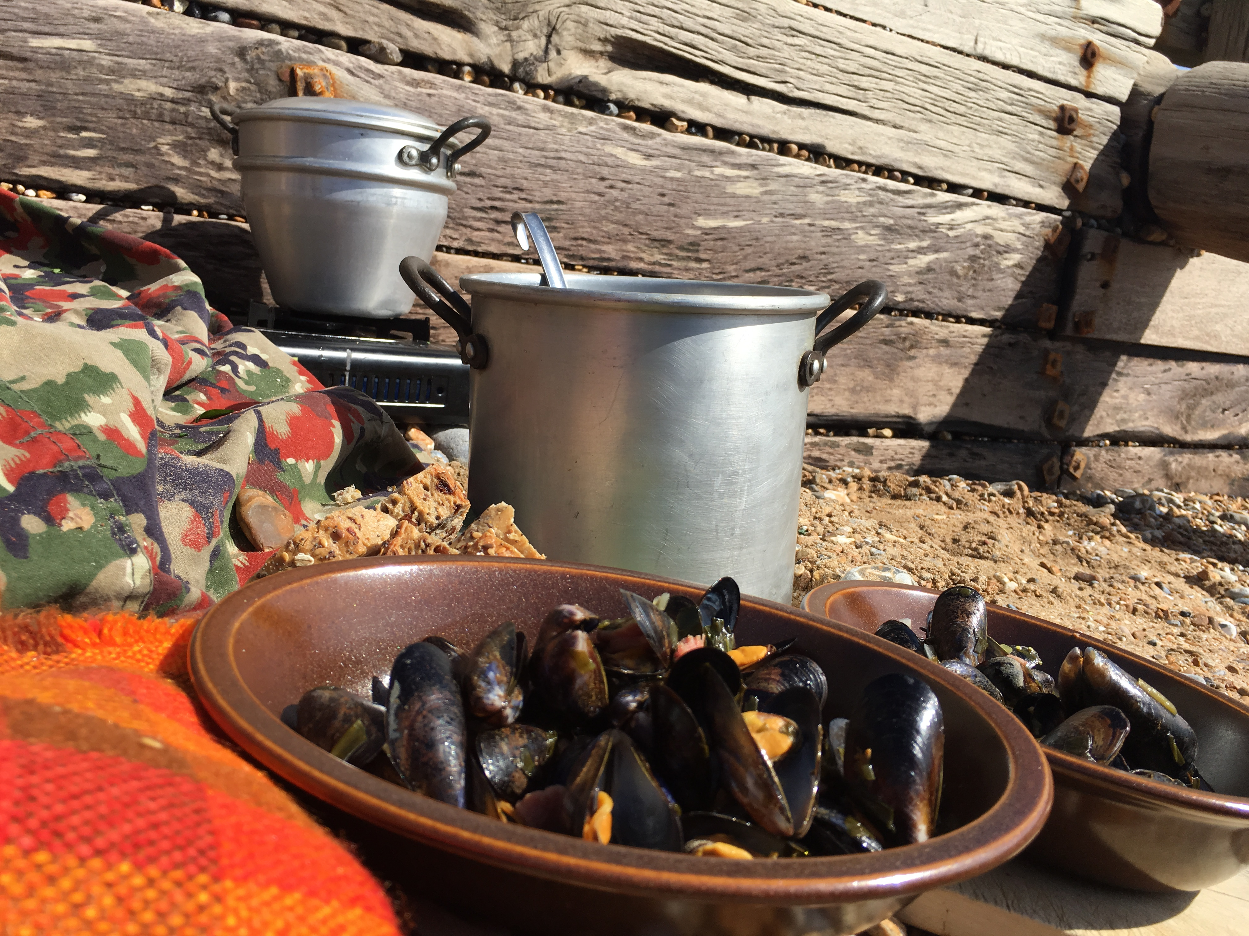 mussels cooked on the beach with freshly pricked wild garlic, bacon and cider