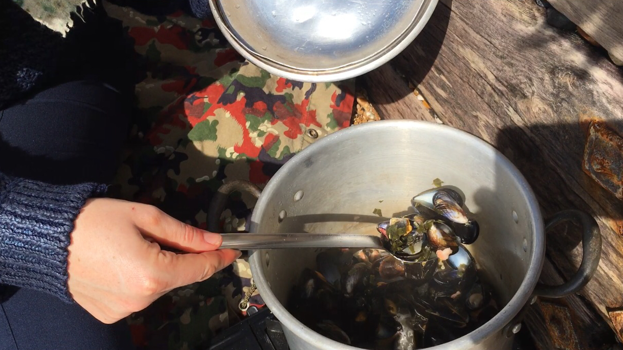 Mussels cooked on the beach with freshly picked wild garlic, bacon and cider