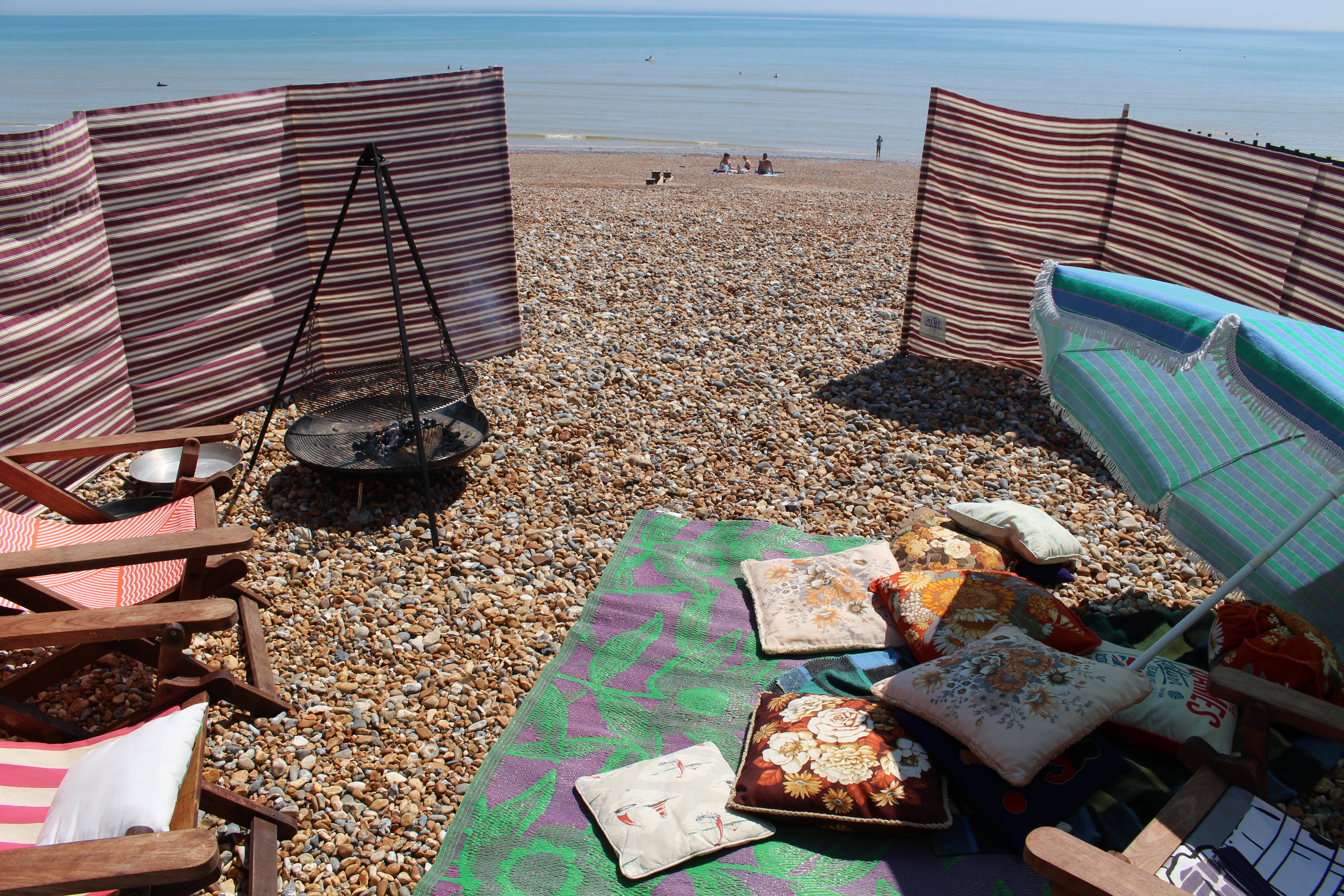 Beach Hut Set Up. Cooking on the beach with blanket and cushions to relax on while dinner cooks