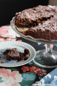 A gluten free, richly dark and decadent chocolate and coconut cake with desiccated coconuts and ground almonds - Beach Hut Cook