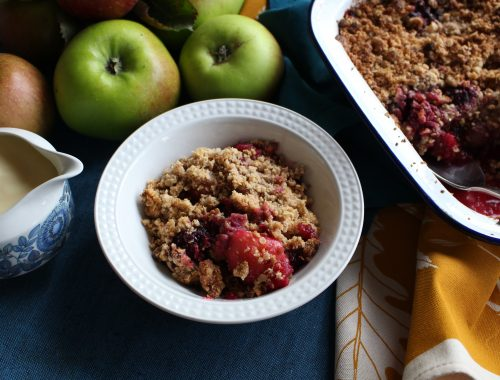 Gluten Free Peanut Butter Apple and Blackberry Crumble. A cold weather dish of sweet soft apples with dark blackberries and a crunchy oaty topping flavoured with peanut butter