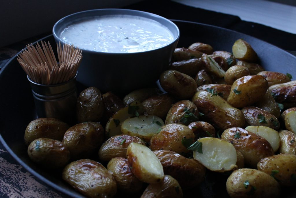 A simple creamy dill dip made with a mix of cream cheese and Greek yoghurt and served with honey mustard roasted new potatoes makes the easiest of canapes for your next party