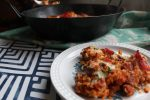 A baked rice dinner of chicken and chorizo cooked in a pasta sauce topped with cheese. The answer to a quick and nourishing after work dinner for busy people.