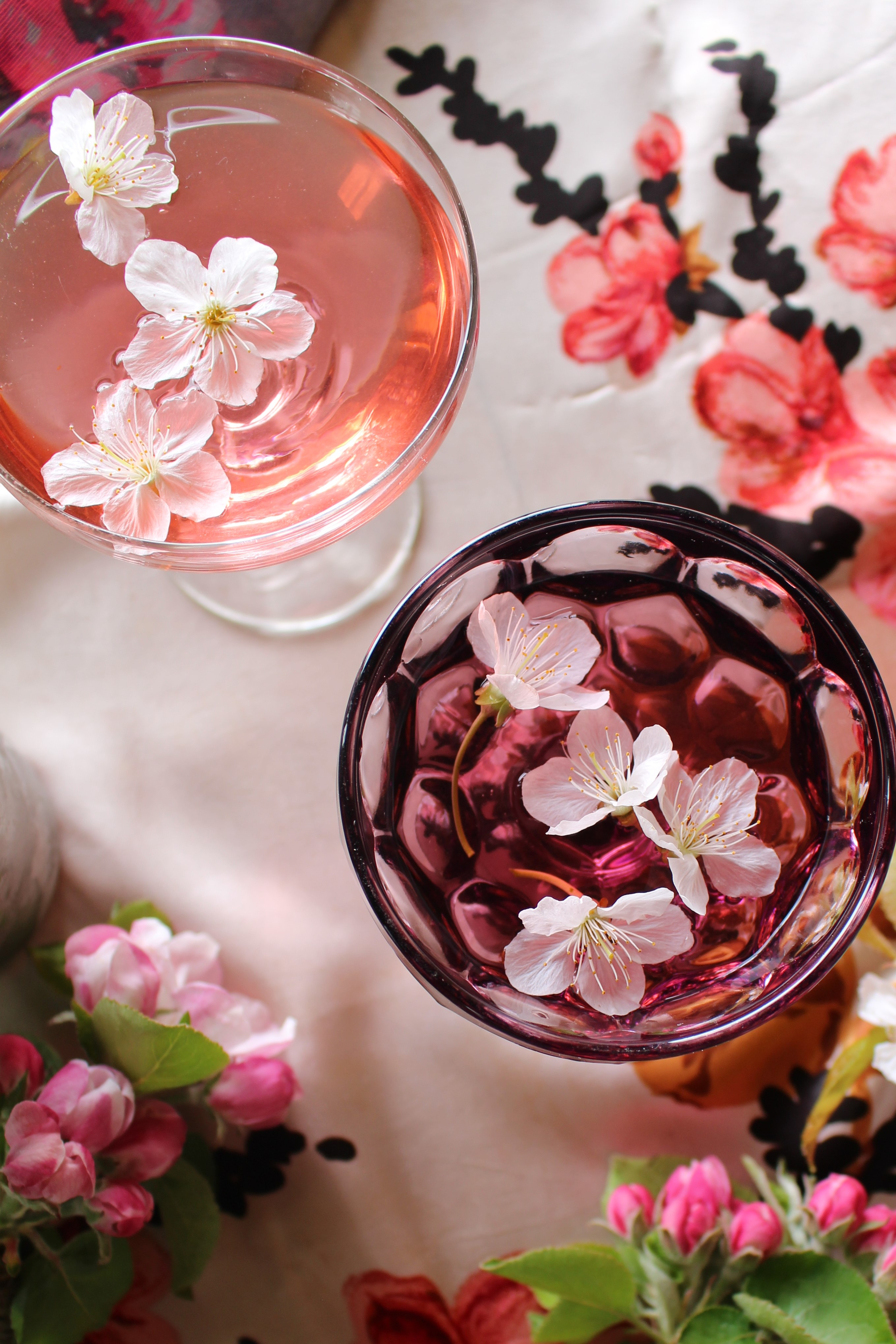 Cherry Blossom Martini using a syrup made from the cherry tree blossom decorated with cherry blossom flowers. Pretty and delicate with a hint of almond.