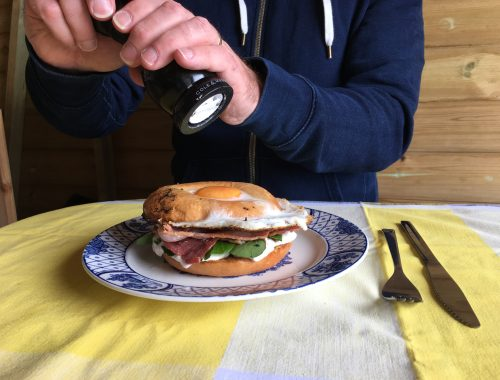 Egg filled bagel with bacon, chilli jam, watercress and cream cheese