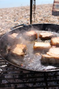 Beer drenched pork belly slices roasted then flame grilled