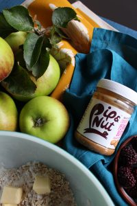 Gluten Free Peanut Butter Apple and Blackberry Crumble. A cold weather dish of sweet soft apples with dark blackberries and a crunchy oaty topping flavoured with peanut butter, Pip and Nut Buuter