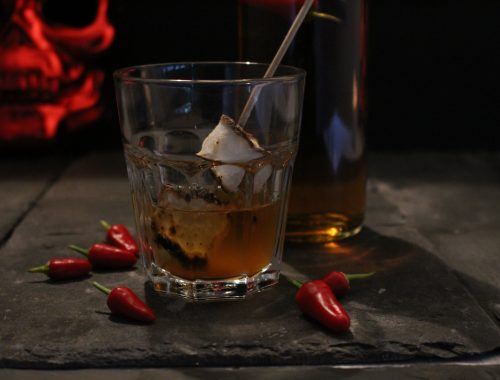 Halloween Cocktail. Marshamallow Bourbon is a laced with chilli and stired with a flaming toasted marshmallow stick.  Spicy and sweet.